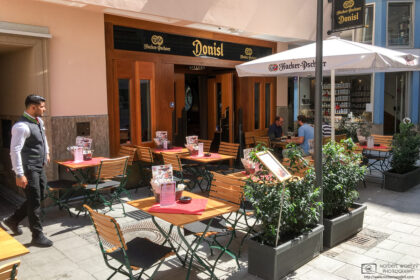 A summer scene at the traditional Donisl restaurant in the historic city center of Munich, Germany.