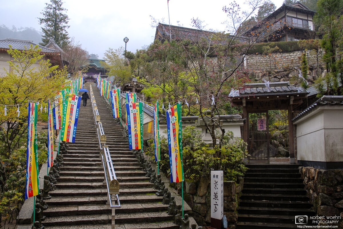 A rainy day for climbing the stairs to the main premises of Daishoin Temple on Miyajima Island in Hiroshima Prefecture, Japan.