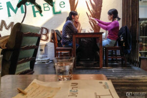 At the delightful Cafe Marble in Kyoto, Japan, two customers are enjoying a relaxing discussion.