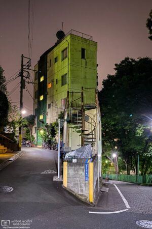 A distinctively shaped building fills the space inside a hairpin turn in the Itabashi ward of Tokyo, Japan.