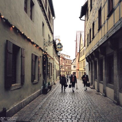 Musicians are walking along Heugasse in Rothenburg ob der Tauber, Germany, on their way to a Christmas season performance.