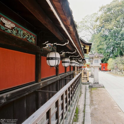 A perspective shot along the decorative details of the Honden, the Main Hall at Kitano Tenmangū Shrine in Kyoto, Japan.