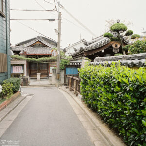 A quiet corner in the backstreets of Nara, Japan, close to Jōtokuji Temple whose premises are visible to the right.