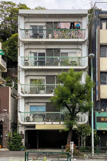 A colorful balcony on the upper floor of this apartment building in the Azabu-jūban area of Tokyo, Japan.