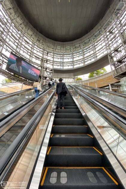 Social-distancing marks are painted on the steps of an escalator to Mori Tower in Roppongi, Tokyo, Japan.
