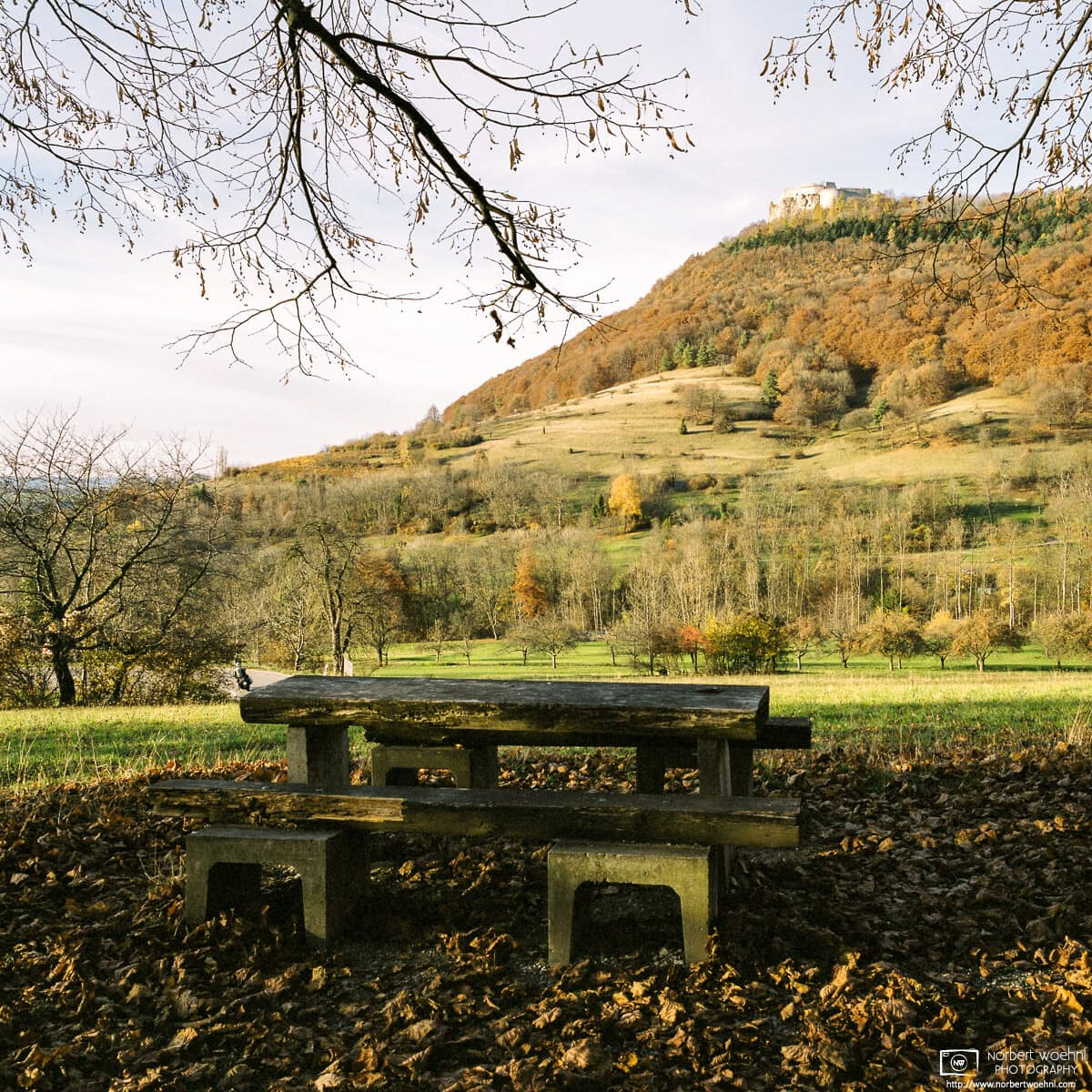 This bench at a picnic area offers a pleasant view of Hohenneuffen Castle in southwestern Germany.