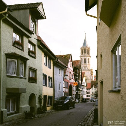 View along a line of old houses towards Kapellenkirche, one of the churches in Rottweil, Germany.