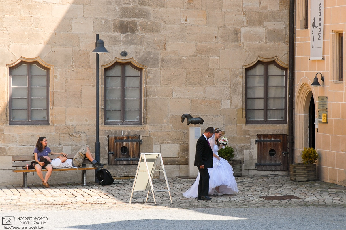 Two couples at different stages in their lives, as seen at Hohentübingen Castle in southwestern Germany.