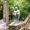 A smiling Buddha statue along the ascent to the main hall of Nanzoin Temple in Sasaguri, Fukuoka, Japan.