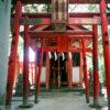 A line of torii gates outside a small side shrine on the premises of Sumiyoshi Jinja in Fukuoka, Japan.