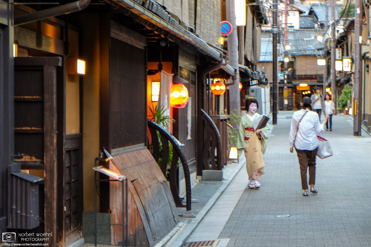 An early-evening encounter with a Maiko in the Gion district of Kyoto, Japan.