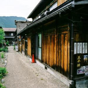 View along a line of eateries in the historic Ogimachi Village of Shirakawago in Gifu Prefecture, Japan.