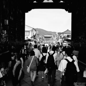 On the approach to Zenkoji Temple in Nagano, Japan, visitors are passing through the Niomon Gate.