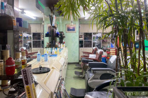 A retro-style interior as seen through the window of a barbershop in Otsuka, Tokyo, Japan.