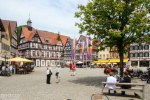 A view across the historic Market Square of Bad Urach in Southwestern Germany, with the town hall at the back left.
