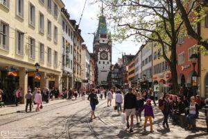 View towards Martinstor (Martin's Gate) in the city center of Freiburg im Breisgau, Germany.