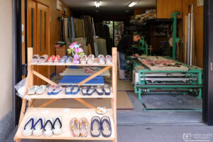 A tatami maker in the Fushimi area of Kyoto Japan is displaying a variety of tatami sandals for sale.