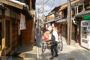 Tourists are enjoying a jinricksha tour in the Higashiyama area of Kyoto, Japan.